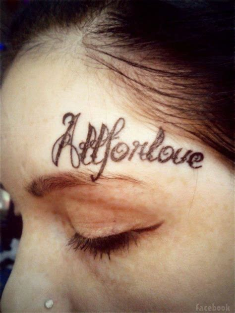 above eyebrow tattoo photos lesya toumaniantz has s name tattooed on