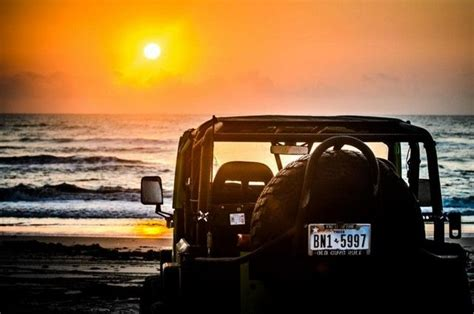 jeep beach sunset driving off road into the sunset modern jeeper