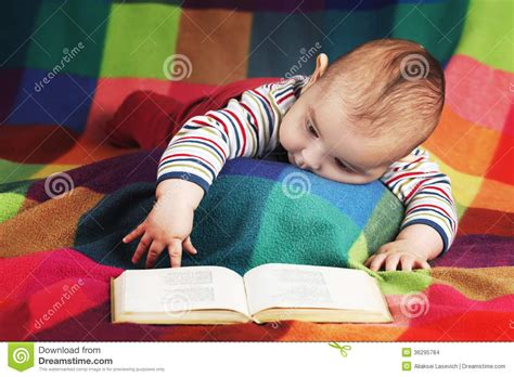 baby pictures book baby reading book stock photo image of