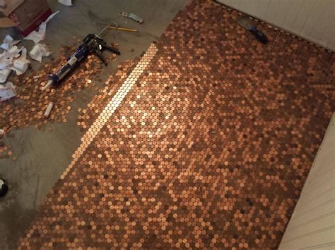 he made an awesome penny floor out of old pennies you can too