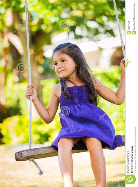 girl on swing girl playing on swing set stock image image 33587561
