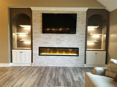 linear fireplace with tv above electric home