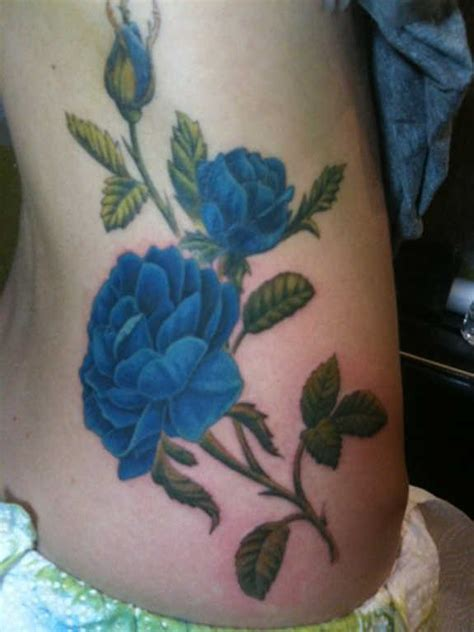 blue rose tattoos meaning 37 exclusive blue tattoos and designs