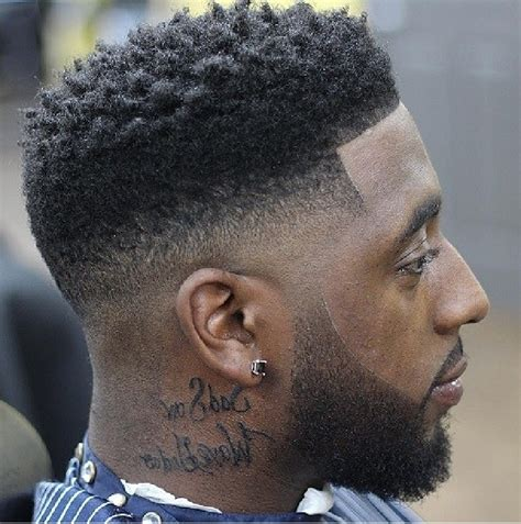 black men haircut hair ob top faded on sides and in back different types of fades haircuts for black men black