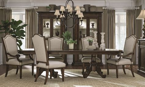 chateaux walnut pedestal extendable dining room set