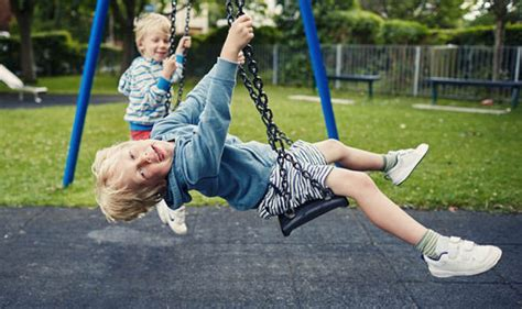 real swing kids playing on the swings really is good for children this