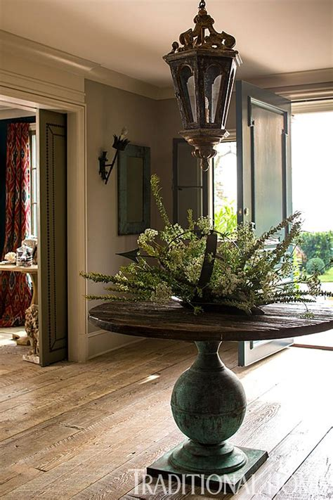 Entry Table Set An Antique Pedestal Table In The Foyer Sets The Home S