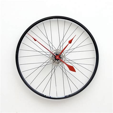 clock made of clocks clock made from a recycled bike wheel