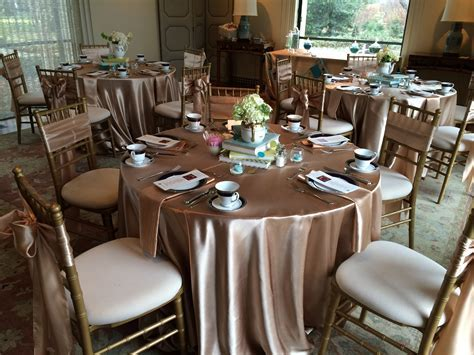 Champagne Satin tablecloths, napkins, and sashes   AM