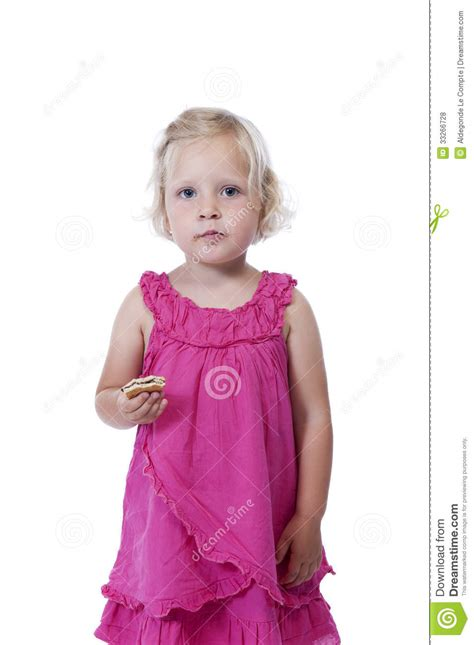 angry little girl in pink isolated on a white background little girl in pink eating a biscuit isolated on white