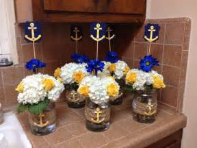 Yellow blue flower arrangement for a nautical theme baby shower more