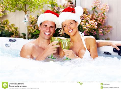 couples in bathtubs happy christmas santa couple in jacuzzi stock image