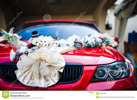 wedding car audio dolls and flower decoration on car royalty free stock