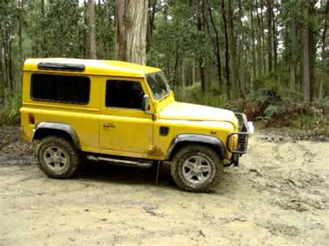land rover defender 90 yellow land rover yellow defender 90 in mud youtube