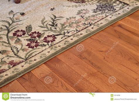 how to shoo area rugs on hardwood floors area rug royalty free stock photos image 1614258