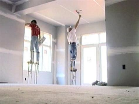 how does it take to install a ceiling fan closing up the walls hanging drywall diy