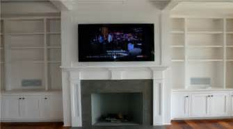 fireplace mantels with tv above fireplace mounting a tv