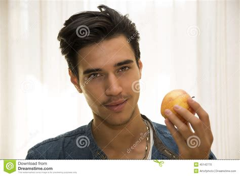 man holding young man holding a large delicious ripe stock image