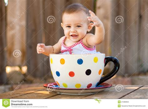 Unique Coffee Mug by Happy And Cute Baby In Giant Teacup Stock Images