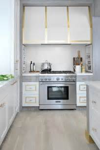 white and gold range cooking alcove spice shelves design ideas