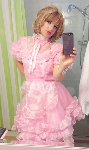 free pictures of sissy he looks wonderful in his pink and ruffles and petticoats
