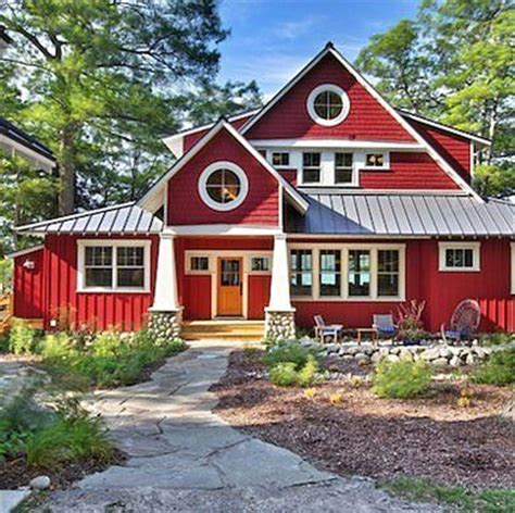 red siding house red white house board batten nautical style cottage farmhouse round windows