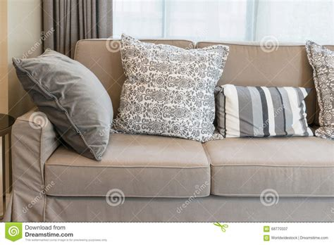 grey patterned couch sturdy brown sofa with grey patterned pillows stock photo