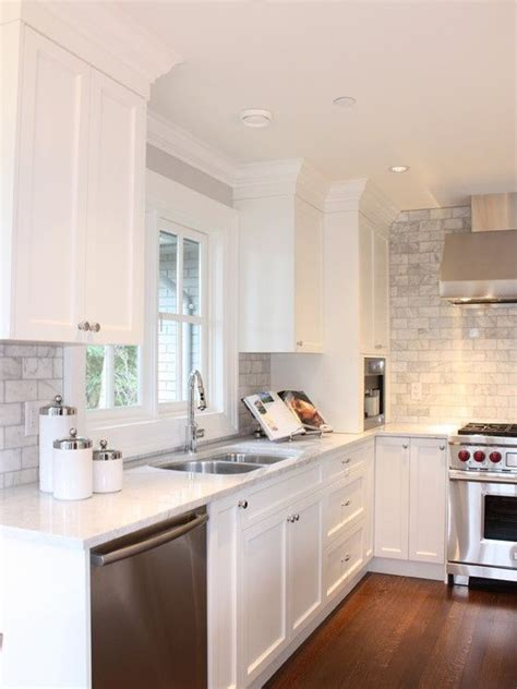 stunning white subway tile backsplash with white shaker