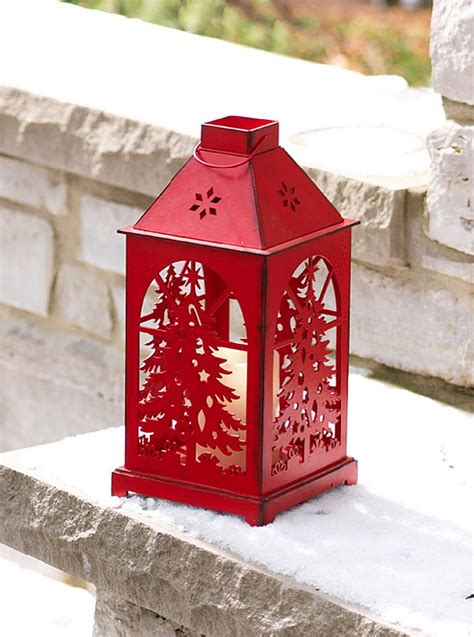 red flameless christmas candle lantern with cut out tree