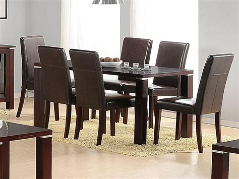 mahogany wooden dining table   brown faux chairs