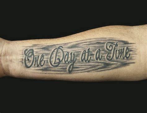 arm tattoos for men quotes one day at a time quote on black background on arm