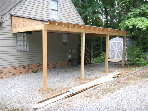 building an attached carport car port with one side as privacy fence garden shed