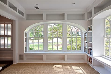 window side seat how to use bookshelves to maximize storage without