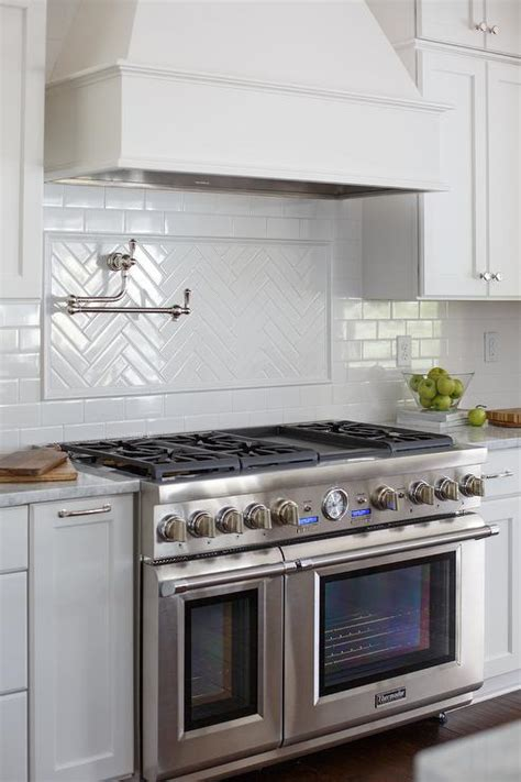 backsplash cooktop white herringbone stovetop tiles with swing arm pot filler
