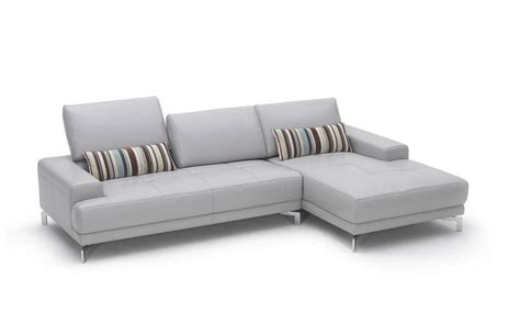 sleek white contemporary sectional sofa with side pouches