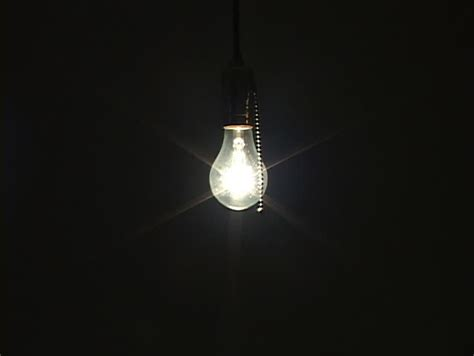 swinging light swinging light bulb with alpha included stock footage