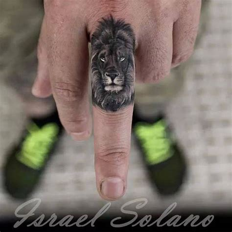 tattoo finger lion black and grey lion tattoo on the left middle finger