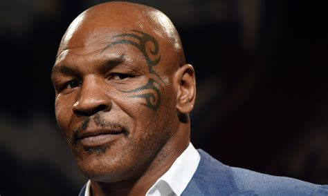 mike tyson doesn t regret getting his face tattoo a lot