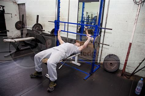 what does bench press do smith machine flat bench press wide grip