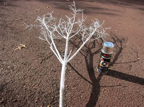 spray painting tree branches decorating sparkly branches