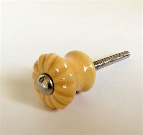 mini scalloped yellow gold porcelain cabinet knobs small