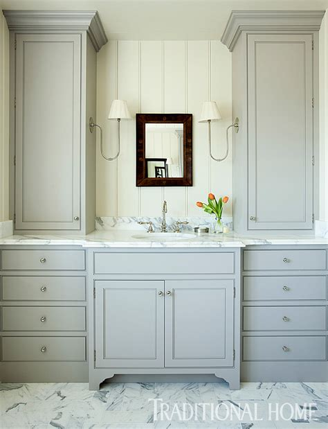 pale gray vanity cabinetry with furniture style legs gets