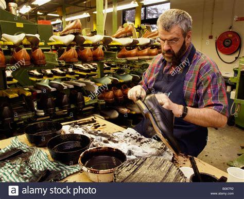 shoe factory gentleman working in a shoe factory doing work