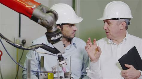 Factory Manager by Factory Manager Explains To Younger How The Machinery Works Clip 22843282