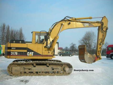 Cat Consruction cat 317 1999 caterpillar digger construction equipment photo and specs