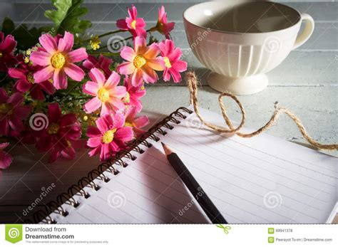 Floral Pencil Coffee pencil on book with flowers and coffee cup stock photo