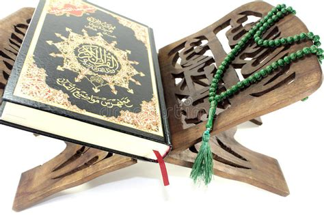 stand  quran  green rosary stock image image