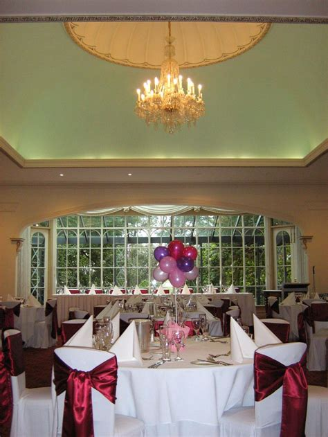 Dining Room Table Centrepieces Reception Setup With Burgundy Sash S And Baloon Centrepieces Dining Room