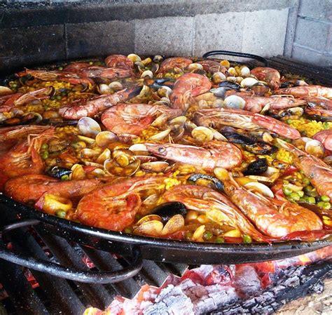 come cucinare la paella di pesce paella di pesce spagnola ricetta originale mammachepaella