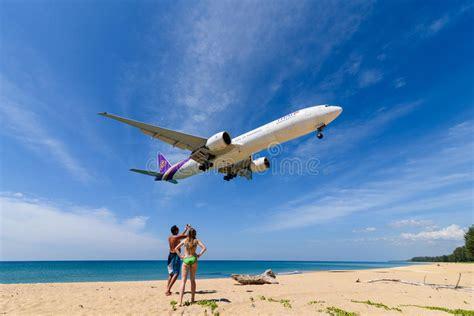 thai airways airplane boeing 777 landing at phuket airport editorial image image of